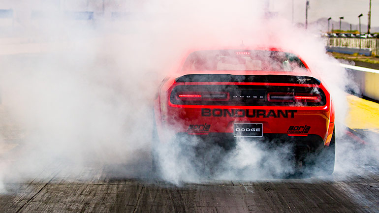 Bondurant Drag Racing - Dodge Demon burning out. Close up rear quarter panel