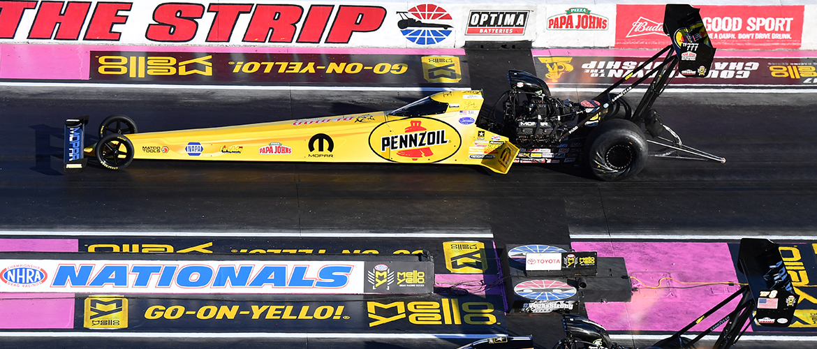 Two top fuel dragsters racing at Vegas nationals