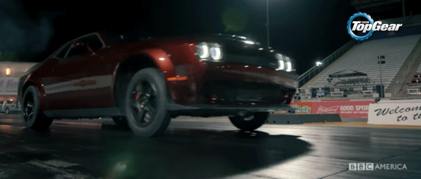 Red Dodge Demon launches wheelie