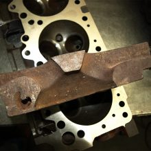 cut-away of an un-machined, raw cylinder head casting