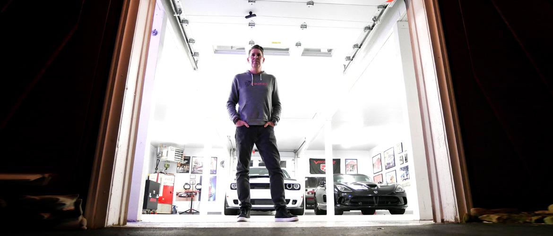 Man standing infront of his garage