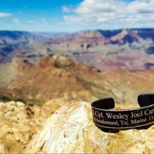 Shot of the Grand Canyon with a bracelet in memory of Marine Wesley Joel Canning