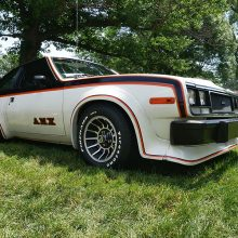 AMX older white car with black and orange detailing