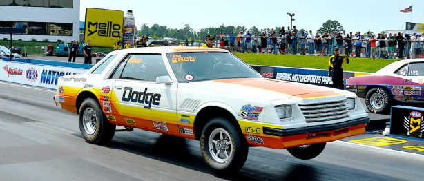 Old Dodge vehicle taking off at a race
