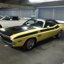 With its correct fiberglass hood, rear-mounted radio antenna, stagger-sized E and F-series tires, side-exit exhaust, console shifted TorqueFlite automatic and 340 6-barrel small block, this well-restored 1970 Challenger T/A (Lot 740) hammered for $72,600. Born with the optional 3.91 rear axle ratio (3.55 was standard on T/A), it still has its original matching numbers engine block, a rarity due to the 340's quick revving nature and propensity for damage at the hands of lead-footed drivers.