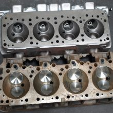 This comparison of 392 HEMI (First Generation, top) and 426 HEMI (Second Generation) heads highlights how totally different each engine family is. We were surprised to learn the 426 head (58.2 pounds) is 6.2 pounds lighter than the 392 head (64.4 pounds). Both are lighter than the popular Chevy 454 big block head (68.2 pounds).