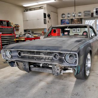 Old Dodge challenger primed in a shop