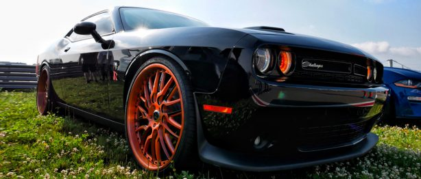 Black Dodge Challenger with orange detailing