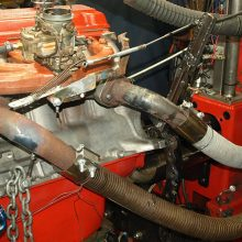 Mounted to the test engine, the added exhaust capacity bumped output by an extra 11.4 hp and 11.1 lb.-ft. over the center-dump factory log. The rearmost exhaust manifold is configured with a horizontal outlet to clear the factory starter motor location (not present). R.A.D.'s Land & Sea engine dyno has its electric starter motor meshed to the flywheel at the end of the engine.