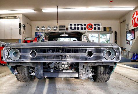 Primered Dodge Challenger at shop getting restored