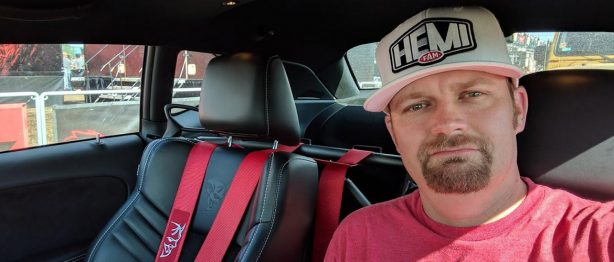 man taking a selfie with a hemi fan hat on