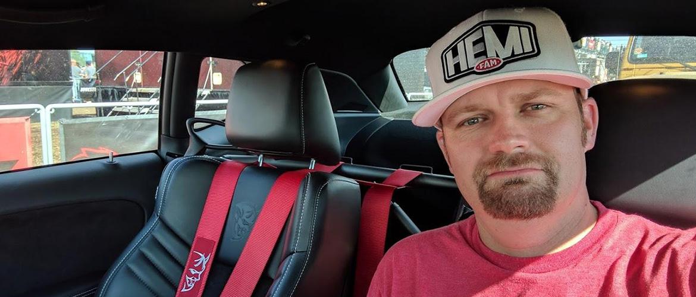 man taking a selfie with a hemi fan hat on