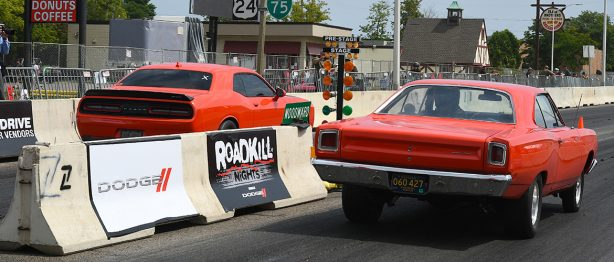 Two read cars racing at Roadkill nights