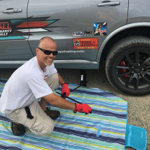 Steve fixing a flat tire on his Dodge Durango SRT