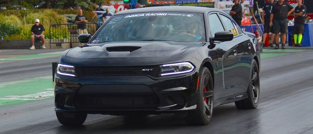 Black Dodge Charger Hellcat racing at NMCA World Street Finals