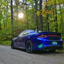 Blue 2018 Dodge Charger SRT Hellcat driving along tree-lined street