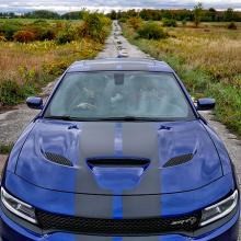 Blue 2018 Dodge Charger SRT Hellcat parked on rural abandoned road