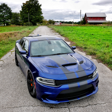 Blue 2018 Dodge Charger SRT Hellcat parked on a rural farm