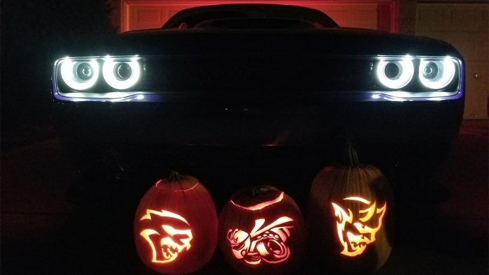 Dodge Hellcat, Angry Bee and Dodge Demon pumpkin in front of the front end of a Dodge Demon