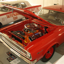 The 1964-65 Race HEMIs lacked the visual dazzle of the GTO and Mustang but took the Package Car theme to new heights. The only customer options were color, transmission type (4-speed stick or TorqueFlite automatic) and tire size. Priced at $4,717 new, this '65 A990 HEMI Coronet sedan is one of 101 built (roughly 50 Dodge 330 Race HEMI lightweight sedans were built in 1964). Note the single headlamp grille. Eliminating the high beams shed nearly 3 pounds.