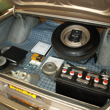 The trunk of this all-original, un-restored 1965 A990 showcases the huge, factory-installed battery