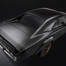 "The 1968 Dodge ""Super Charger"" Concept assumes a ""wide body"" stance thanks to front and rear fiberglass wheel flares painted ""De Grigio"" Grey Metallic body color. Front wheels push forward two inches to accommodate the flares and shorten the Charger's overhang, extending the classic's wheelbase from 117 inches to 119 inches."