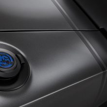 "The Satin Black fuel door of the 1968 Dodge ""Super Charger"" Concept is embellished with a custom-milled aluminum ""Hellephant"" medallion. Vehicle graphics and badging are Satin Black vinyl decals, including the classic tail stripes at the rear."