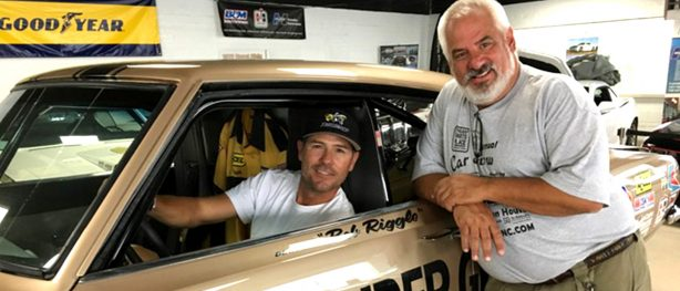 Joe Spagnoli posing with Chris Jacobs in front of fully restored HEMI Under Glass 1969 Barracuda