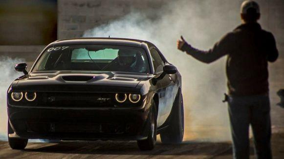 Dodge Challenger SRT® Hellcat doing a burnout before racing