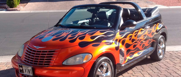 Customized PT Cruiser. Black convertible with red and orange flames