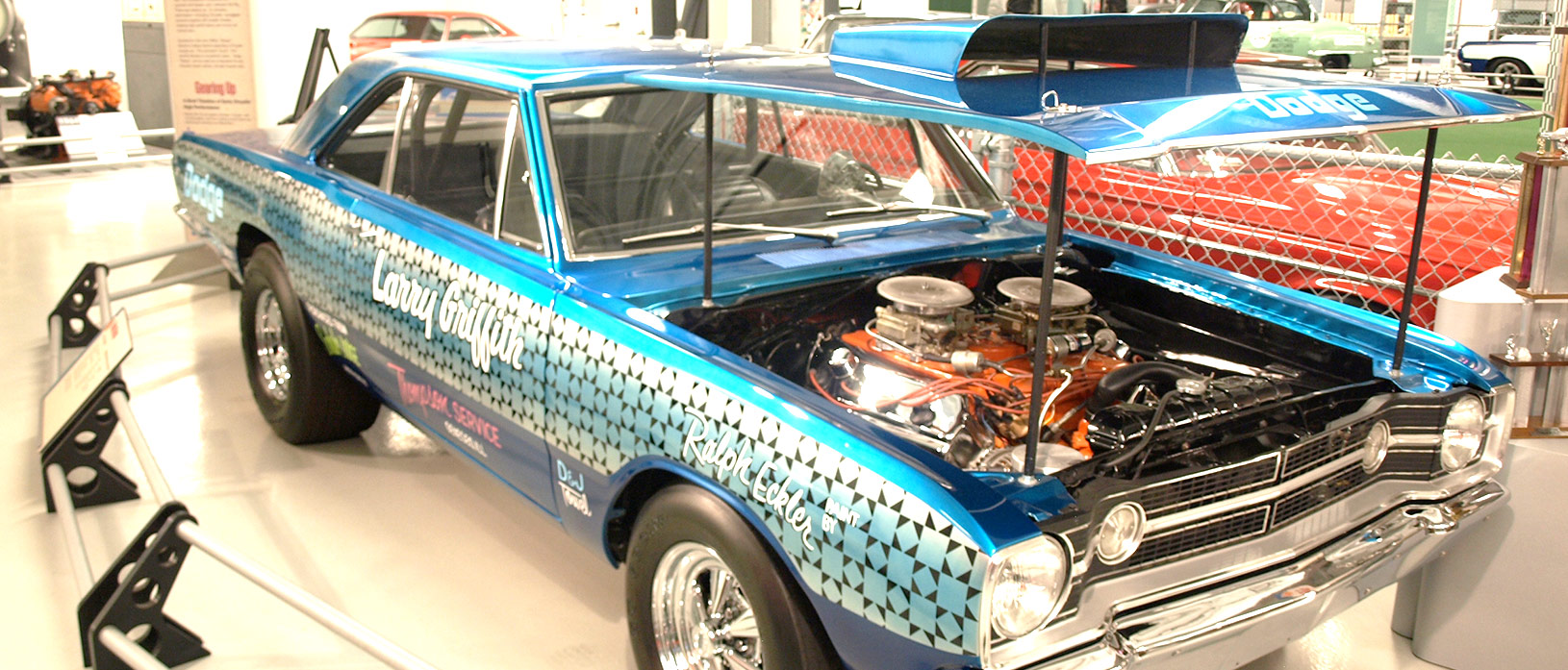 The black underhood paint on Larry Griffith's HEMI Dart is correct. HEMI Darts were partially assembled at Dodge's Hamtramck, Michigan, assembly line as running cars with 383 engines (to prevent a lot of manual pushing). From there, they were trucked to a nearby Hurst modification center for final assembly. To prevent rust, the bodies were painted black (interior, door sills, engine bay, trunk compartment) while gray primer went on the body.
