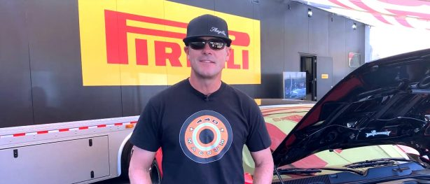 Chris Jacobs at the SEMA show standing in front of SpeedKore carbon fiber body Dodge Demon