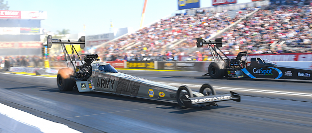 Tony Schumacher's Army Top Fuel dragster racing down the strip