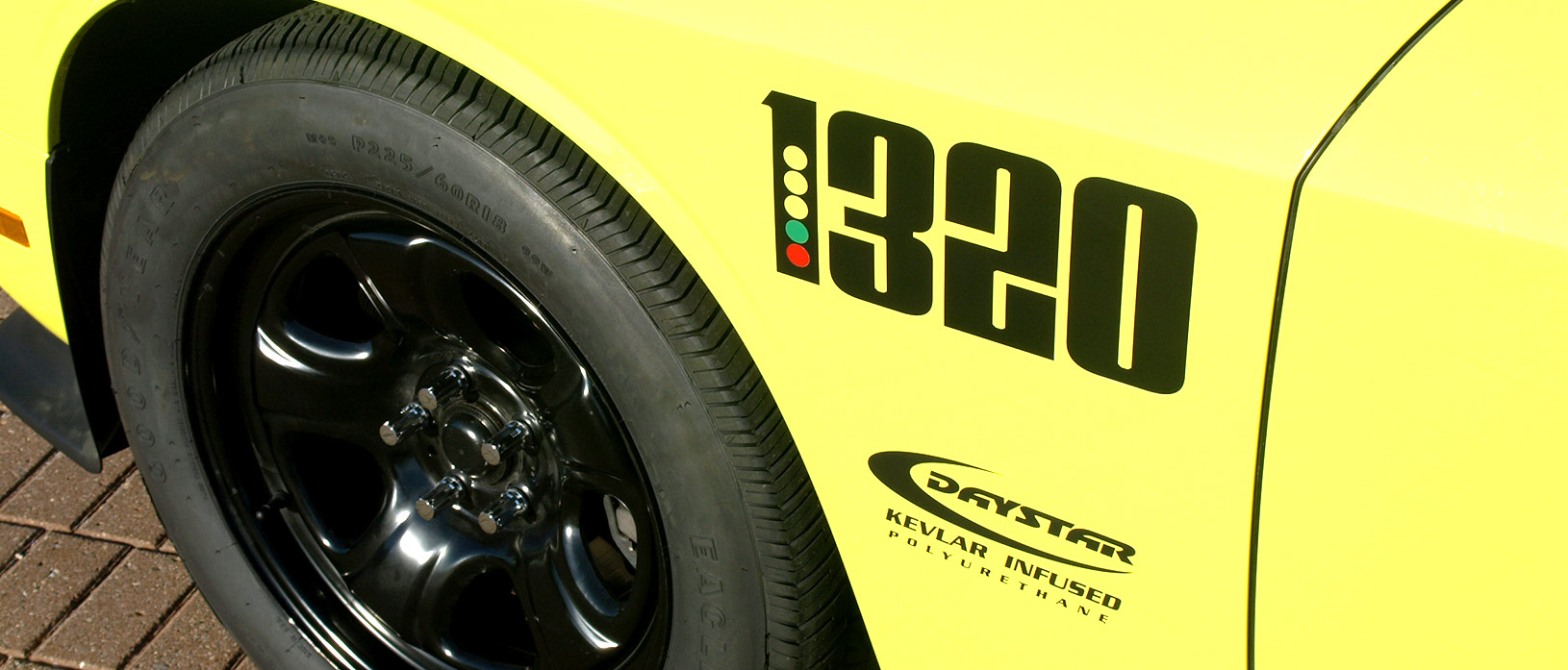 "The 1320 fender logos make inventive use of the iconic drag strip ""Christmas tree"" starting line signal. The comparatively narrow front tires are in keeping with drag strip thinking where wide front rubber defeats quickness through increased rolling resistance and weight."