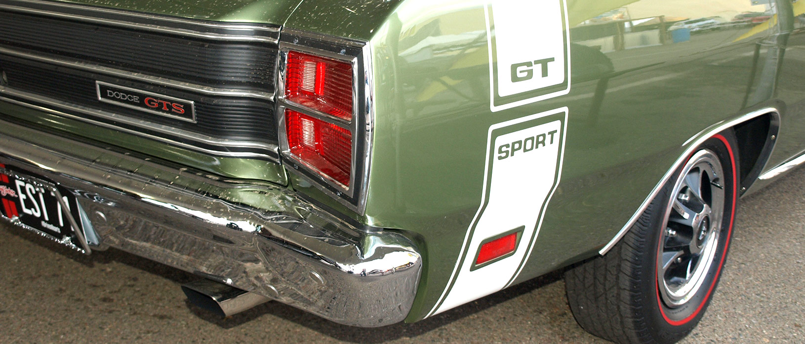Like every member of the Dodge Scat Pack, the 1969 Dart 440 GTS came standard with a Bumble Bee stripe for quick identification. The sinister red-lettered GTS trunk emblem stands for GT Sport. Note the standard issue chromed exhaust tips, a Package Car first.