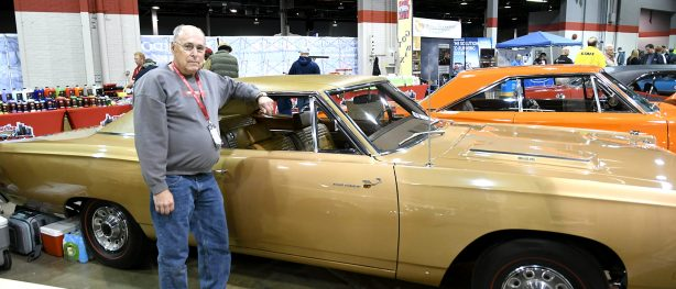 John Manship standing beside his 1969 Plymouth Road Runner at MCACN