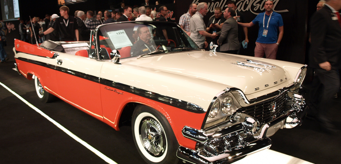Red and white 1958 Custom Royal convertible at Barrett-Jackson auction