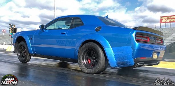 Blue Dodge Demon racing down the track