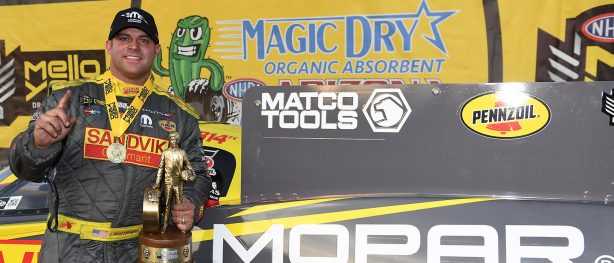 Matt Hagan holding up a Wally trophy after winning NHRA Arizona Nationals