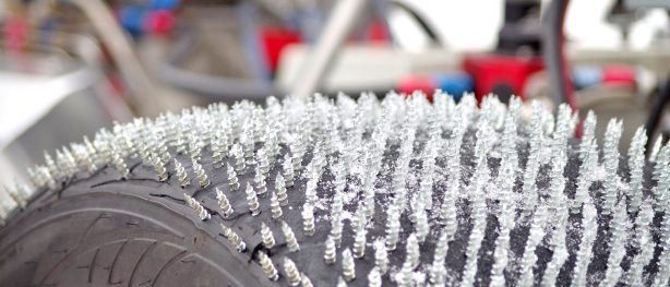 Close up of screws drilled throughout tire making an ice drag radial