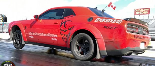 Red Dodge Demon racing down the track
