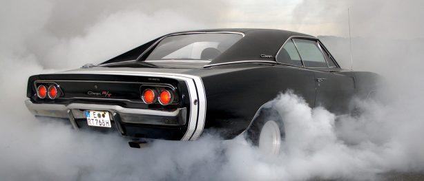 Black Dodge Challenger R/T doing a burnout
