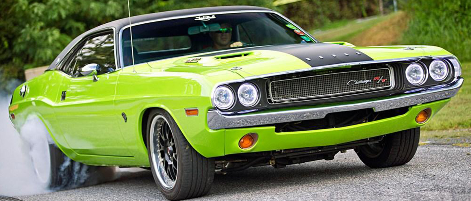 Green Dodge Challenger R/T with flat black hood stripe