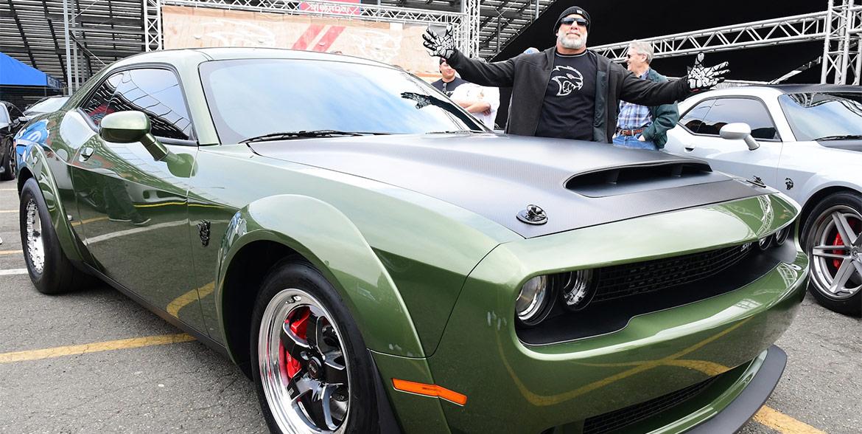 Bill Goldberg standing beside his F8 green Demon