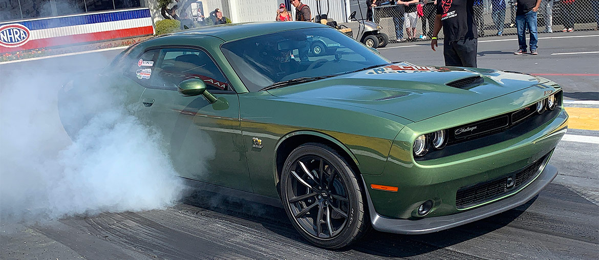 Goldberg doing a burnout in a F8 green 1320 Drag Pack