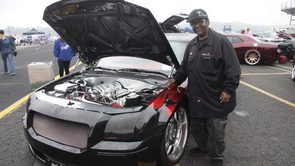 Dodge Charger owner standing beside his car at SpringFest 13