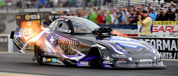 Jack Beckman's Infinite Hero Funny Car racing down the track at NHRA Gatornationals