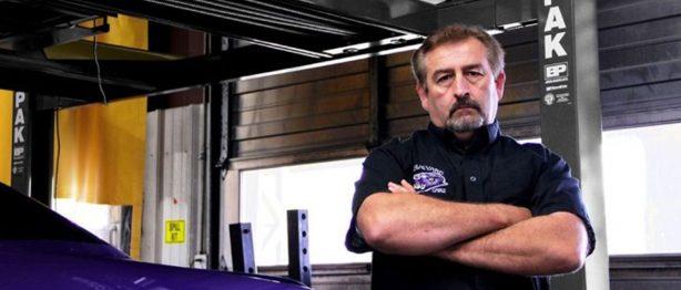 Mark Worman standing beside purple car