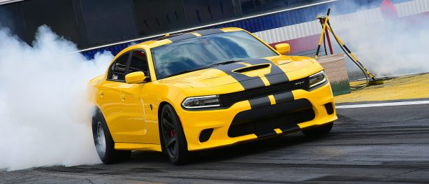 Yellow Charger Hellcat doing a burnout