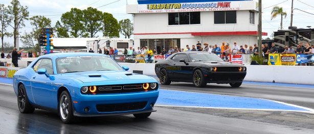 Black Challenger racing a blue challenger at NMCA